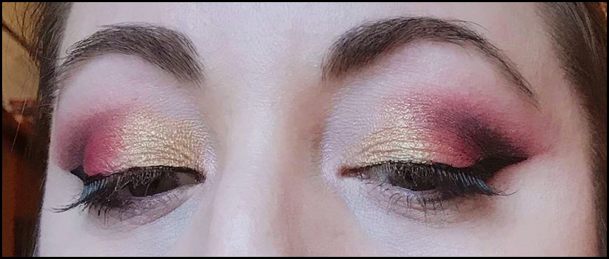 Close up of eye makeup, in red and gold colours
